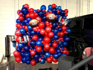 Organic Balloon Wall with Red and White Blue Balloons - Game Night