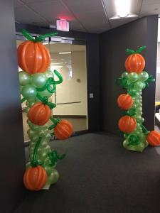 Green Balloon Columns with Fall Pumpkin Balloons