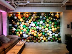 Organic Balloon Wall with Green and White Balloons 1